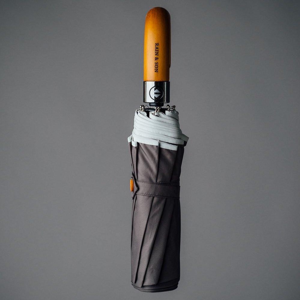 compact umbrella reflective grey fabric