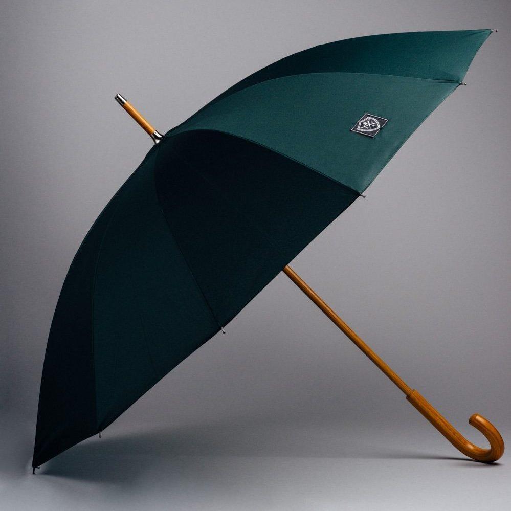 mörkgrönt stort paraply