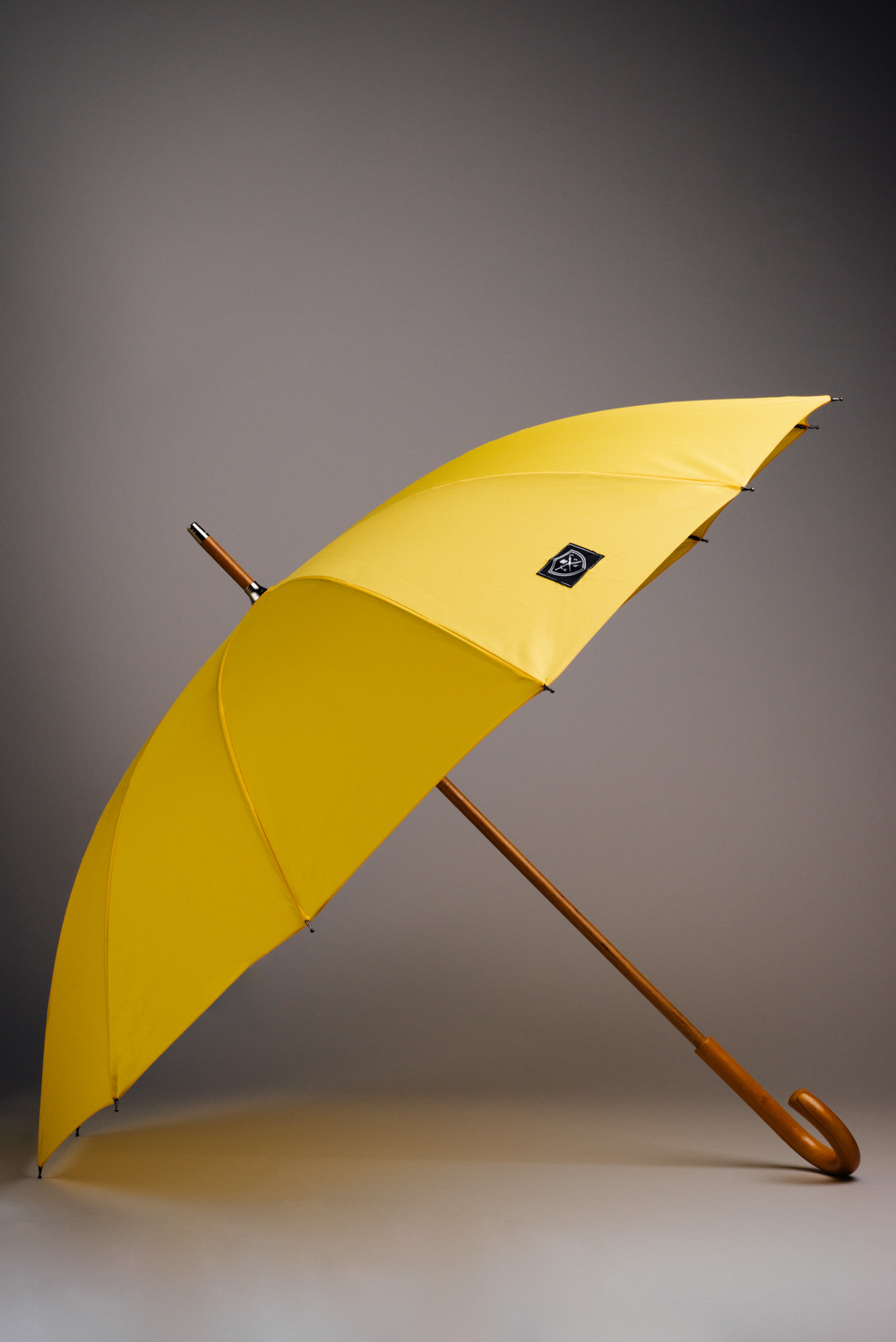 Classic Yellow umbrella with a wooden stick